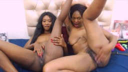Two African black housewives play with double sided dildo
