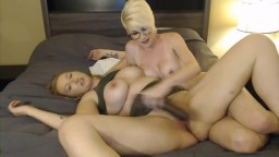 Two hot housewives with big tits enjoy a big black dildo