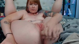 Canadian foxy Ruby Vulpix with sexy tattoos and pink pussy