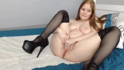 Chubby ginger gal Elise with stockings and high heels
