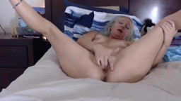 Sexy blonde mommy Nikkay with small tits masturbates