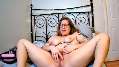 Hairy Miss Springstein in cute glasses squirts like a fountain