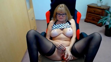 Red hot mature wife in black stockings and sexy glasses