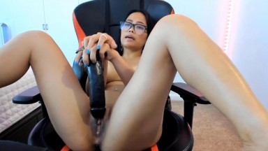 Hottest Asian slut enjoys BBC dildo spreading legs in the chair
