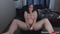 Curvaceous Excella with big boobs masturbates hairy cunt
