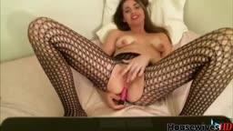 Playful Naughty Nicole in mesh stockings fucks both holes