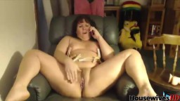 Mature cougar Jeni with a phone and clothespins on nipples