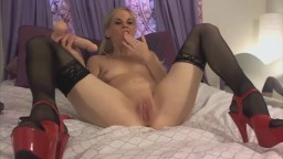 Vivid blonde MILF Candie with high heels and stockings